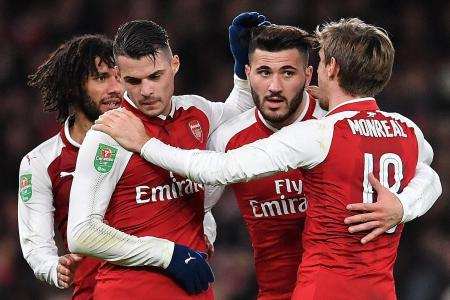 Gunners rediscover fire as they dump Chelsea out of League Cup