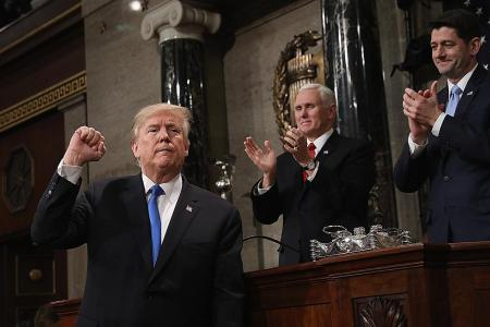 Trump calls for unity after contentious first year