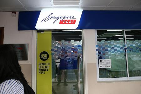 Hunt on for masked man who allegedly stole $3,000 from SingPost branch