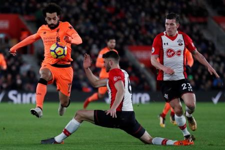 Liverpool go third after 2-0 win over Saints