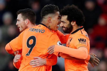 Liverpool defender Robertson counting on Salah, Firmino