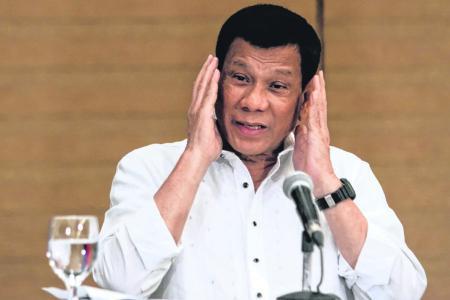 Philippines' Duterte tells soldiers to shoot female rebels' genitals