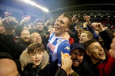Wigan end Man City's quadruple dream