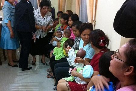 Japanese man wins custody of 13 kids born to Thai surrogates