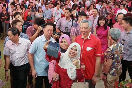 Chinese New Year festivities touch Singaporeans and migrant workers