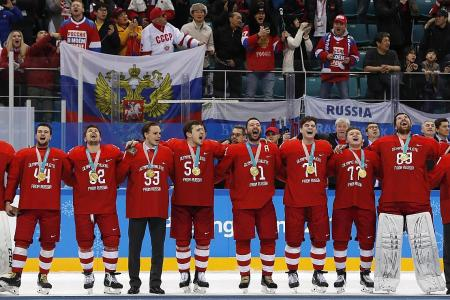 Russian ice hockey gold medallists defy anthem ban