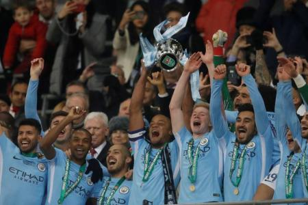 City win first trophy under Guardiola