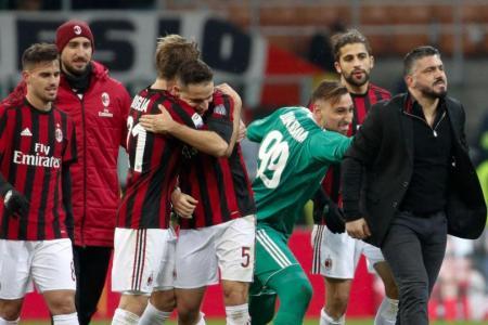 AC Milan players credit their upturn in form to coach Gennaro Gattuso (far right).