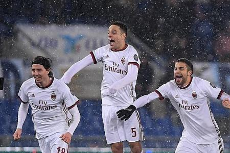 Milan reach Italian Cup final after shoot-out win