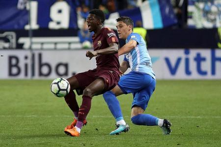 Dembele shines in Messi's absence