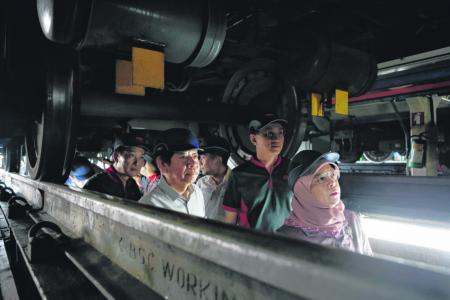 President salutes transport workers during visit to Bishan Depot