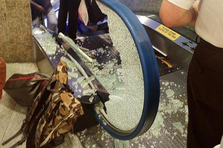 Woman's arm caught in gap between escalator and wall in Bugis Junction