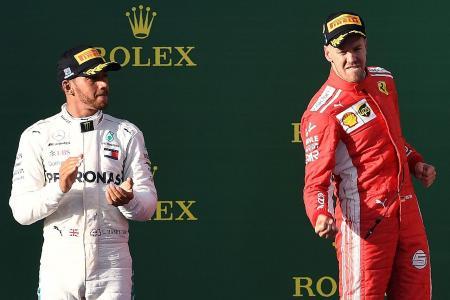 Vettel pips Hamilton for win