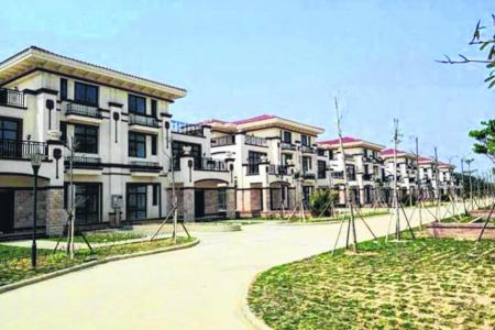 Luxury homes gifted by tycoon empty as villagers fight over ownership