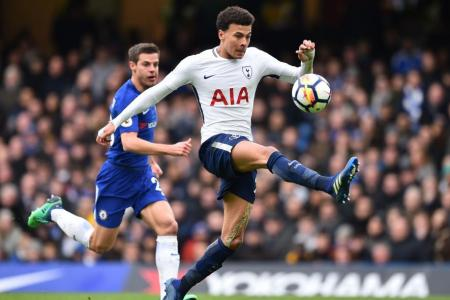 Tottenham Hotspur's Dele Alli controlling the ball before scoring their second goal against Chelsea