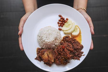 South-east Asians unite to defend non-crispy chicken rendang