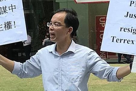 Raffles Place protester jailed and fined