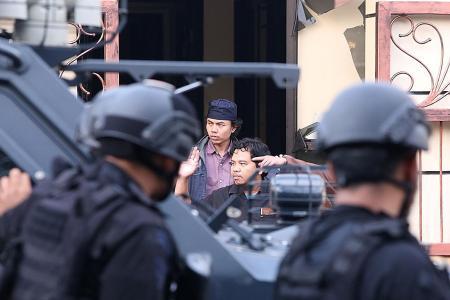 Indonesia cops say prison riot over, killings described as sadistic
