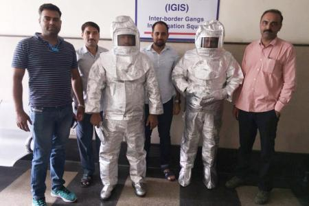 Police parade 'space suit' scammers after NASA claims exposed