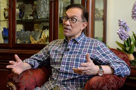 Anwar says 'shattered' Najib called him twice on election night