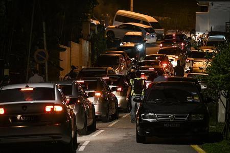 Police raid Najib's house Wednesday night, still there Thursday