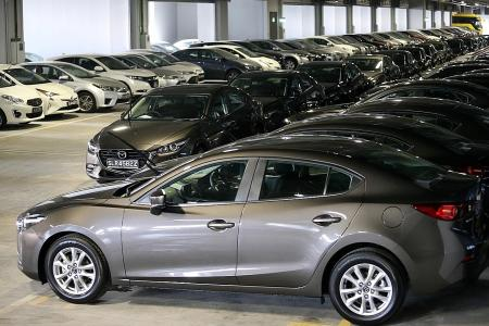COE prices end mostly lower due to Uber's car sales