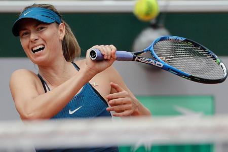 Sharapova digs deep in return to Roland Garros
