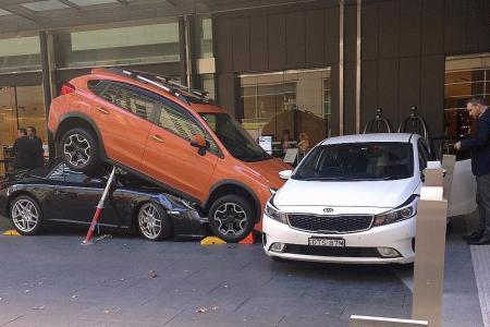Sydney valet drives Porsche under SUV as parking attempt goes awry