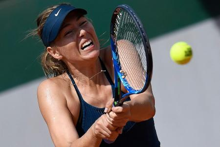 Sharapova grinds out a win
