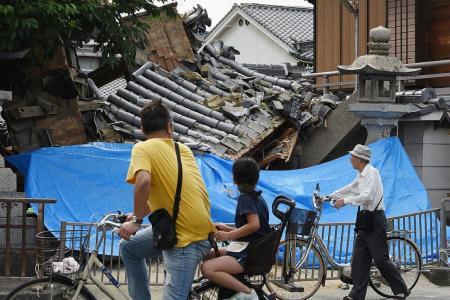 Magnitude 6.1 quake in Osaka kills three, stops factories