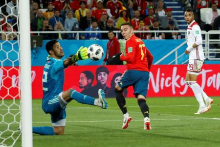Spain given scare, but advance as Group B winners