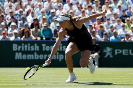 Wozniacki rallies to defeat Kerber, reach final