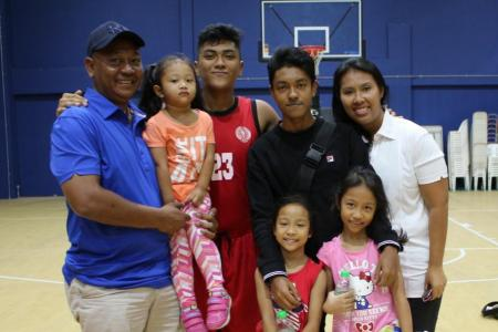 A dad's show of support for son at Asean Schools Games