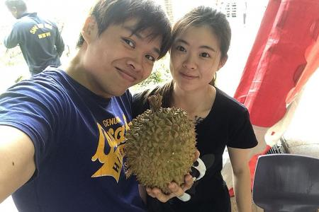 Durian giveaway on couple's 2nd wedding anniversary