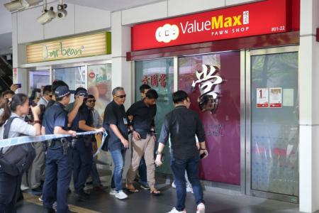 Manager grabbed 'bomb' and threw it out of store