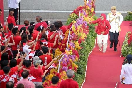 Crowds cheer President Halimah's first NDP
