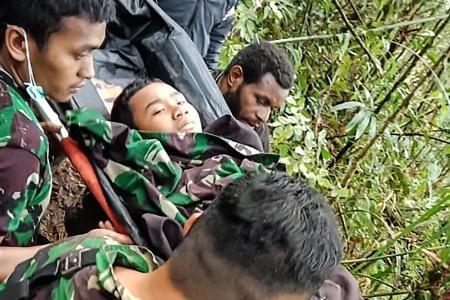 Boy, 12, survives Indonesian plane crash which kills 8