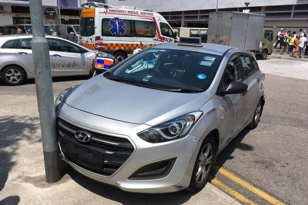 Taxi crashes into wall in Bedok North market, no injuries