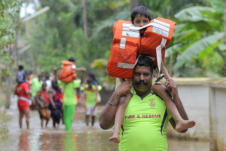 More bodies found in flooded Kerala as toll climbs