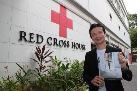 Seasoned fund-raiser donates book sale proceeds to Singapore Red Cross