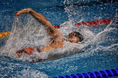 Schooling sets national record in backstroke