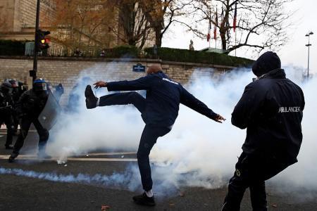 US President retweets false claim that Paris rioters 'want Trump'