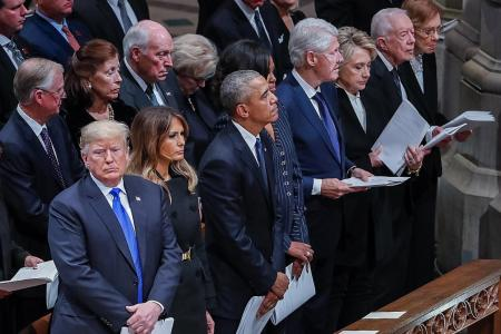 Trump the odd one out at  Bush's funeral