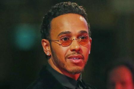 Hamilton sorry for using the word 'slum'