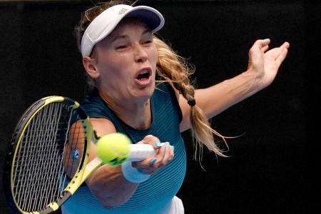 Wozniacki sets up Sharapova showdown