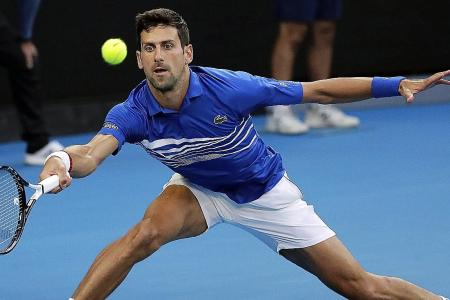 Djokovic delighted with stroll to semi-finals