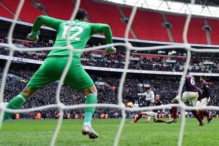 Son strikes again as Spurs go second