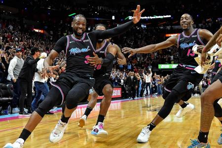 Wade lifts Heat over Warriors