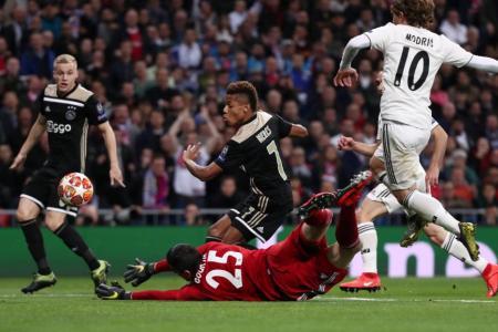 Ajax stun holders Real Madrid to reach Champions League q-finals
