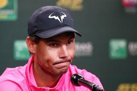 Nadal injury robs Federer of battle with great rival
